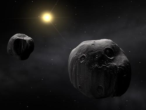 Астероид в космосе